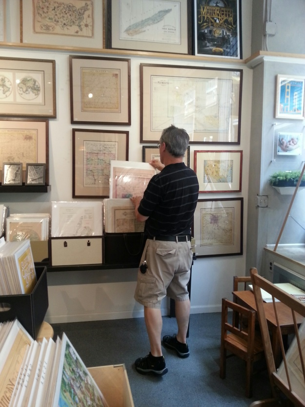 John Ranes examining the maps at Parrish Framing & Art