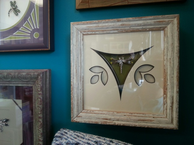 Created with scrap moulding and matting, John Barlow frames small dragonfly pins!