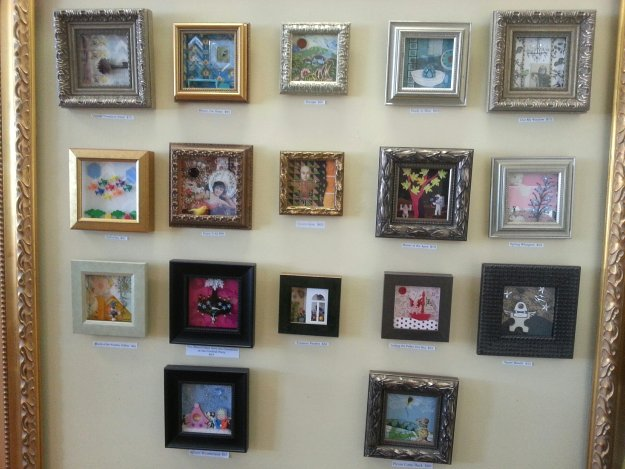 a whole array of fun mini frame shadowboxes on display at casco bay frames gallery