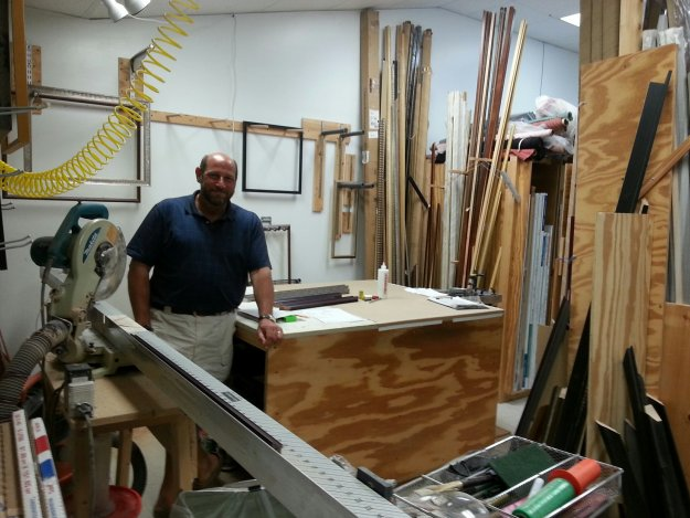 Cliff Wilson of Framed in Tatnuck stands in his moulding cutting room.