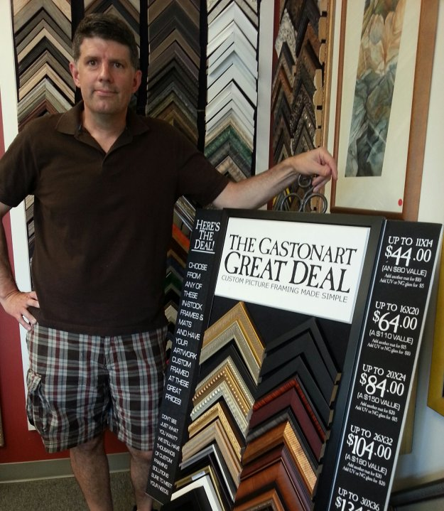 Harry Gaston of Gaston Frame & Art in Shrewsbury, MA showing his Great Deals display.