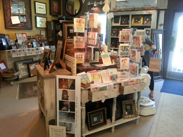 Wonderful attractive displays of gifts, note cards, candles and prints at The Village Framers in Yarmouth, Maine.