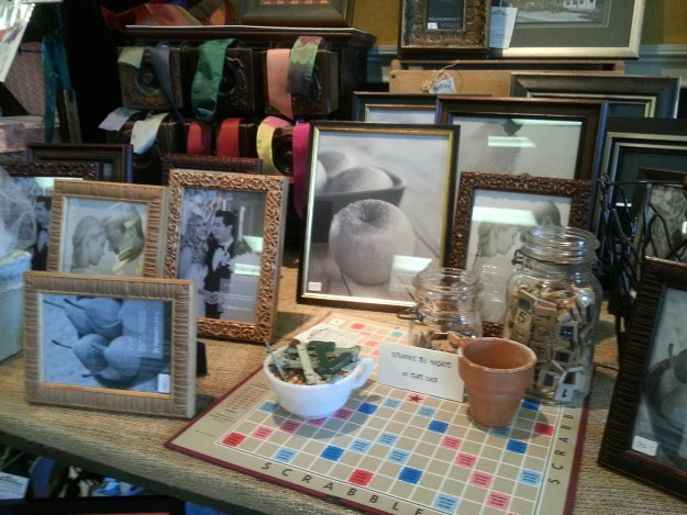 Creative use of supplementary props with photo frames is creatively presented by The Village Framers in Yarmouth ME