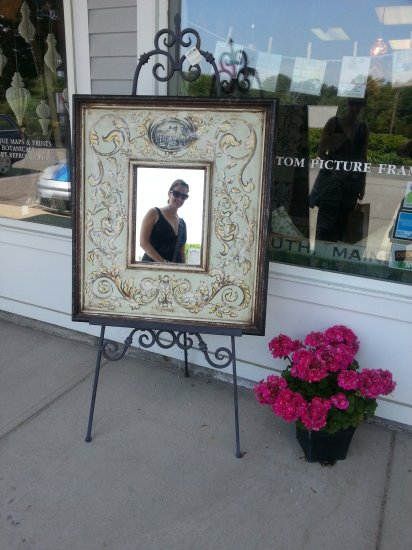 Reflection - Sidewalk display at Village Framers in Yarmouth, ME