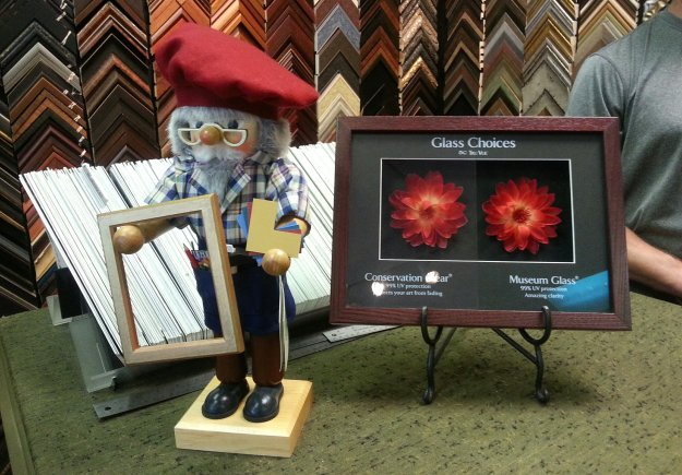 Picture Framer nutcracker joins Tru Vue Museum and Con Clear glass display - design counter - Village Framers